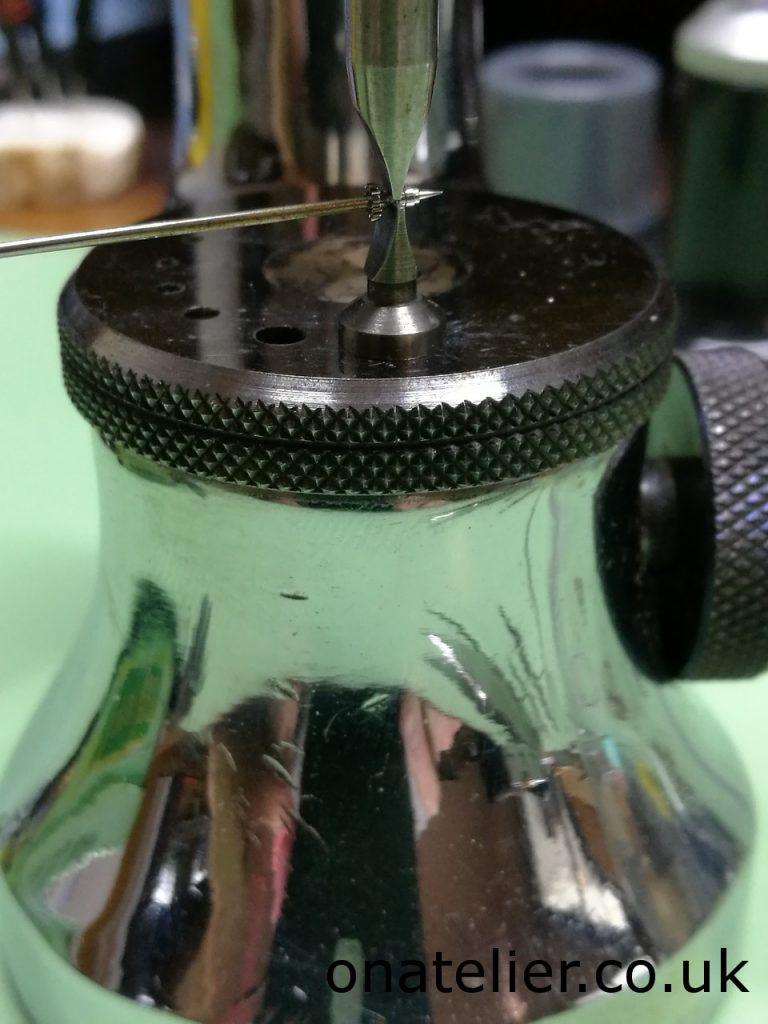 Cannon pinion tightening